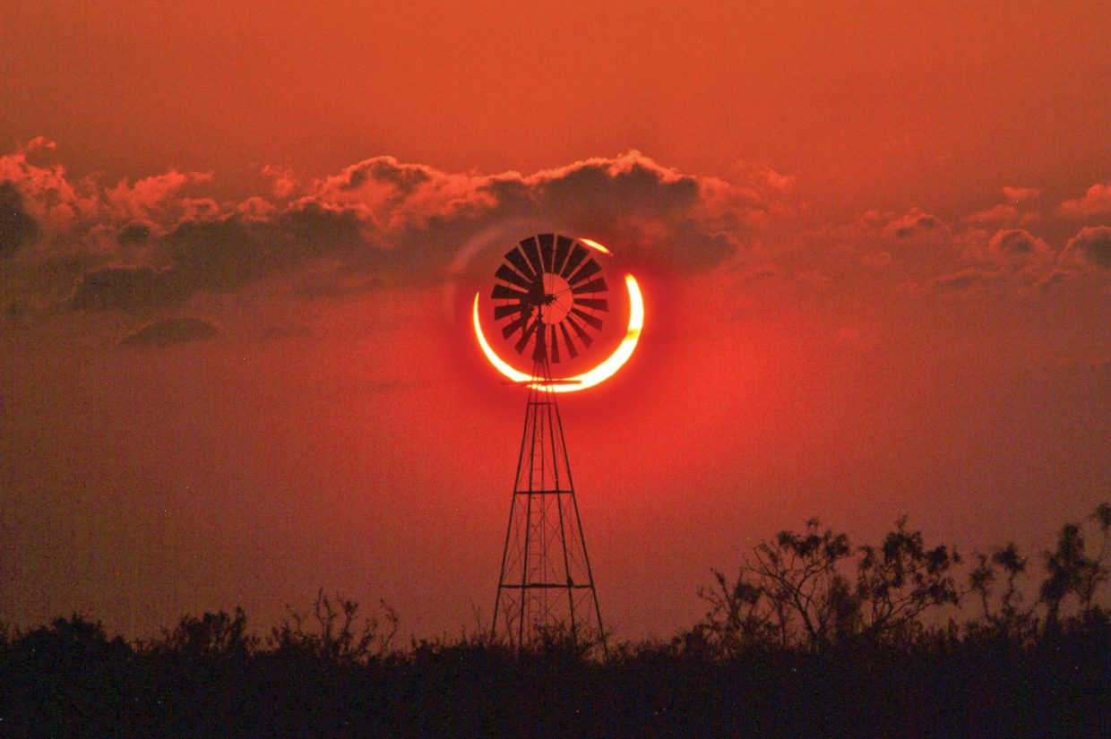 "Right place, right time, right equipment — and a little luck. The sun's ""ring of fire"" was almost perfectly centered behind this lone windmill west of Sundown, Texas, on May 20 for the first annular solar eclipse in nearly two decades."