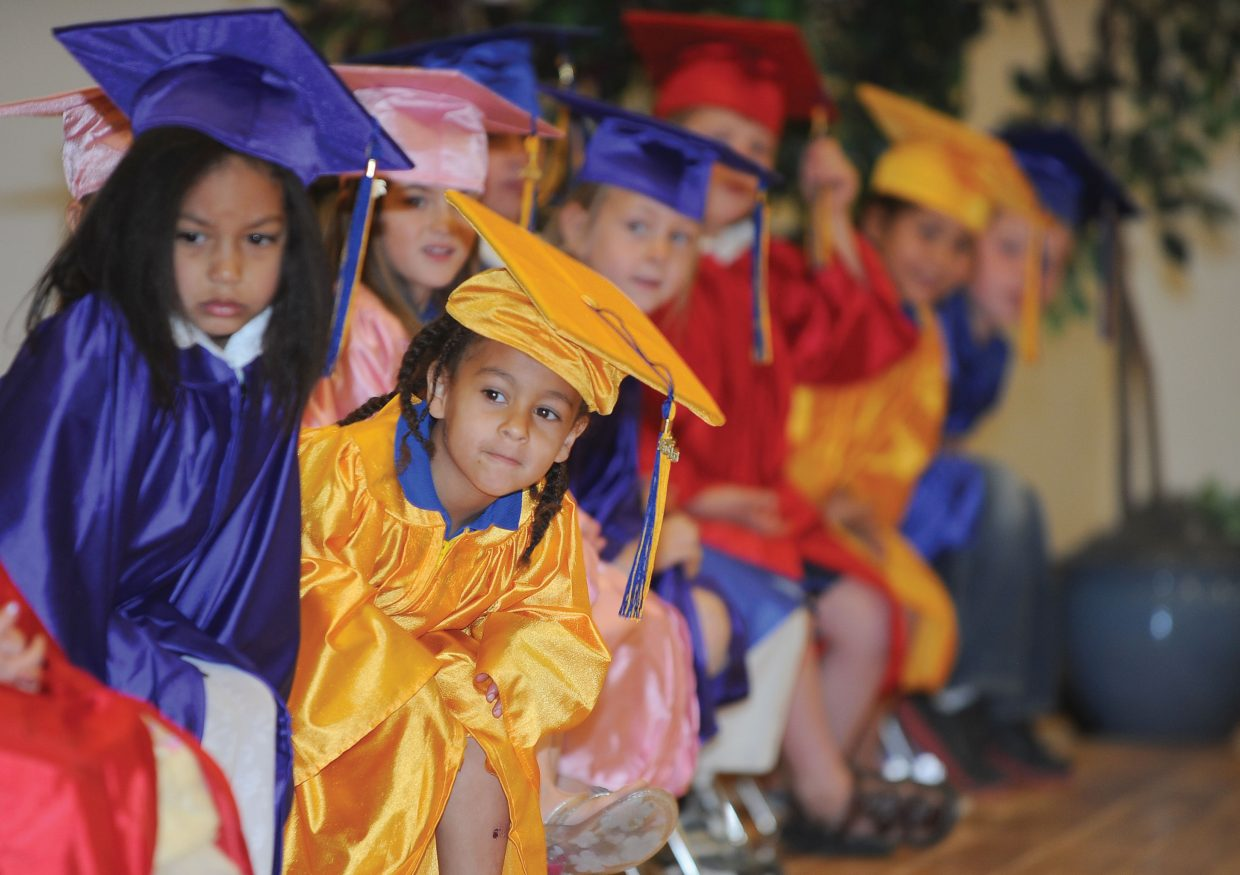 Alina Grant waits for one of her classmates to step to the microphone during the kindergarten graduation at Heritage Christian School in Steamboat Springs. The group of students will graduate from high school in 2025.