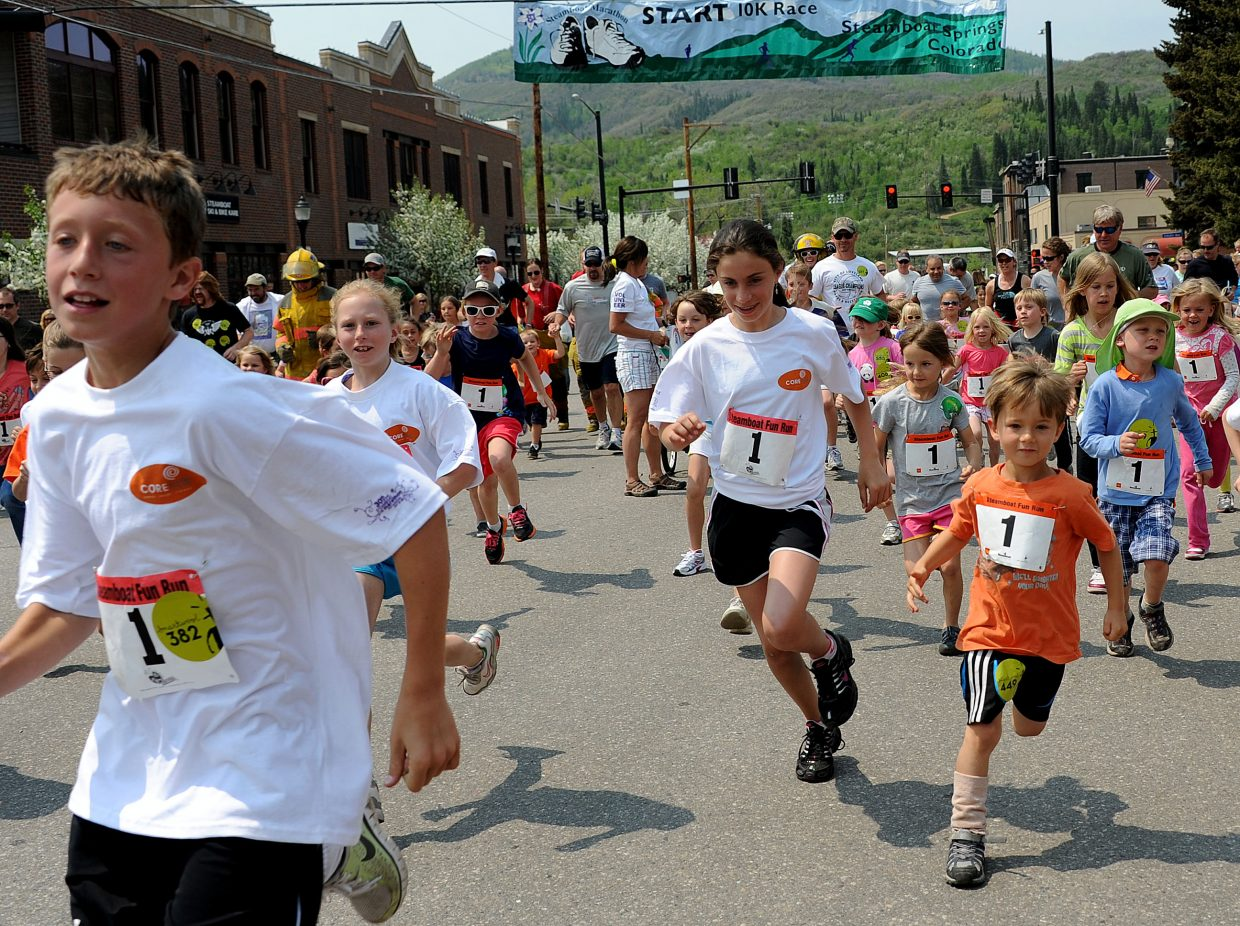Young athletes take off from the starting line of the 1-kilometer Fun Run on Sunday at the Steamboat Marathon.