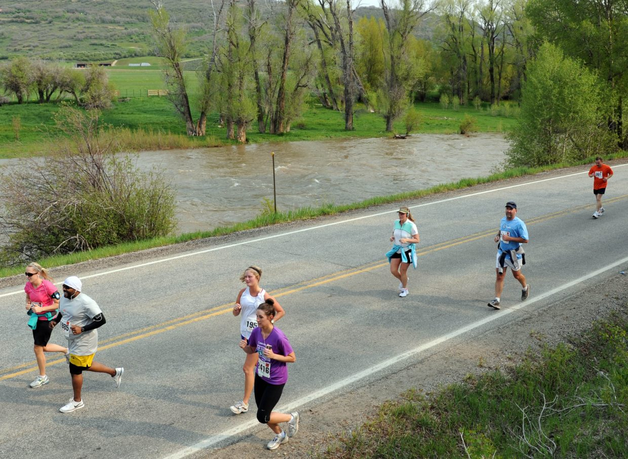A group of runners head toward the finish line Sunday in the Steamboat Marathon.