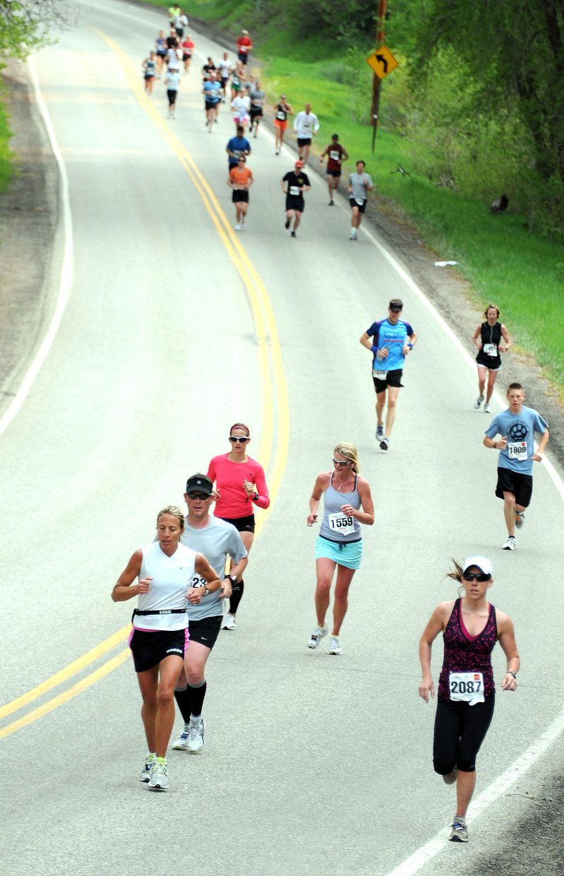 Reall Colbenson, bottom right, leads a pack of runners towards Steamboat Springs on Sunday in the Steamboat Marathon.
