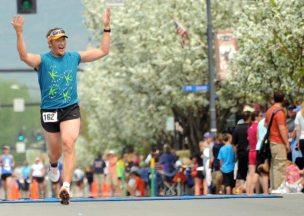 Steamboat's Andy Picking riles up the crowd Sunday as he nears the finish line in the Steamboat Marathon. Picking finished 10th in the race.