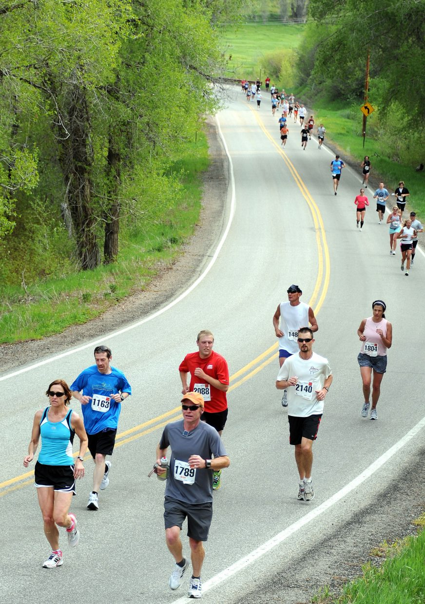 Runners in the half-marathon make their way toward Steamboat Springs on Sunday. More than 2,000 runners took part in the annual Steamboat Marathon, which included a full 26.2-mile marathon, a half-marathon and a 10-kilometer race.