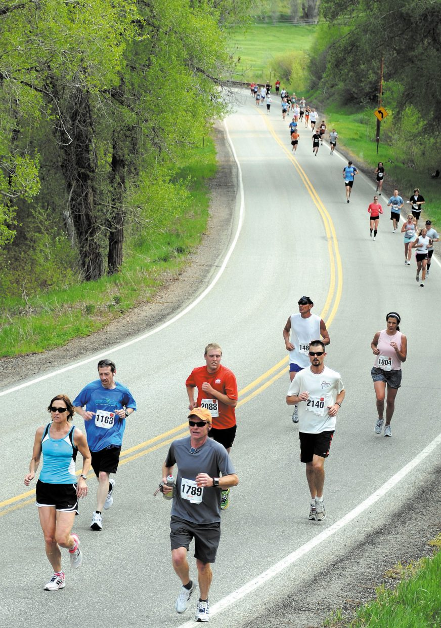 Runners in the half-marathon make their way toward Steamboat Springs on during 2011's event.