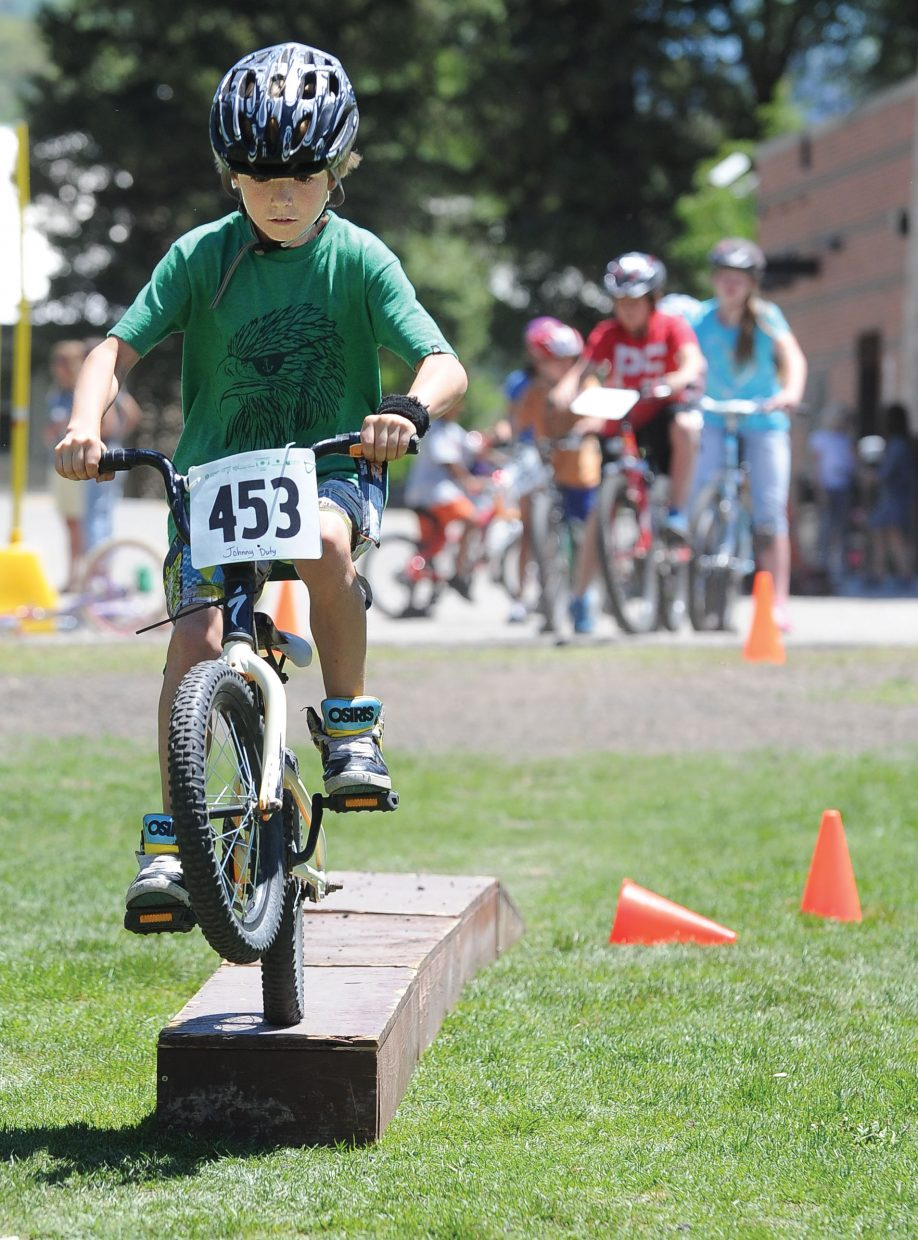 Fourth-grader Johnny Duty rides over one of the obstacles during a bike rally at Soda Creek Elementary School on Wednesday. Students at the school took part in the rally, which included activities to promote a healthy lifestyle and safe biking practices.