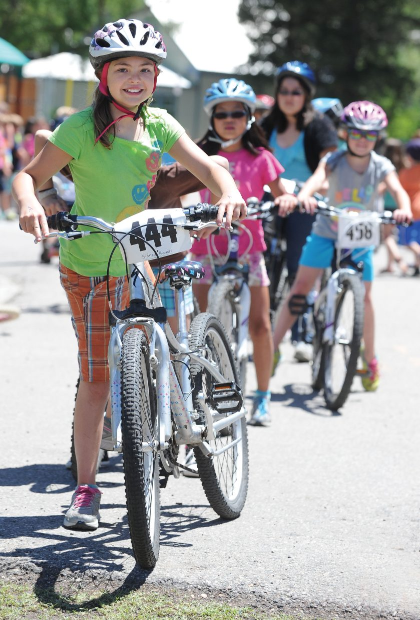 Soda Creek Elementary School student Sidney Barbier gets ready for her turn on the obstacle course during the school's bike rally Wednesday. Students at the school took part in the rally, which included activities to promote a healthy lifestyle and safe biking practices.