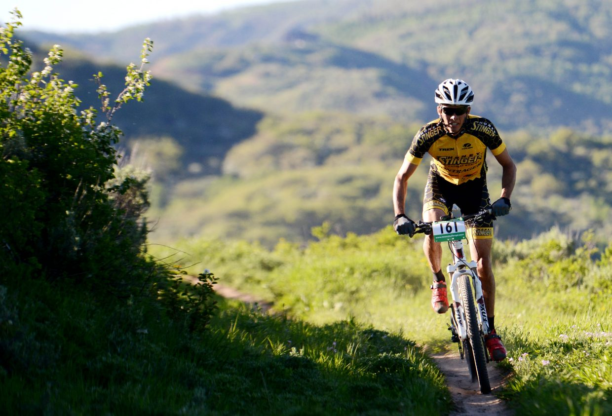Peter Kalmes rides in the sun Wednesday in the Howlin' Howelsen, the first Town Challenge Mountain Bike Race Series event of the season. He won the pro division, leading the way across the Emerald Mountain course for nearly 200 riders.
