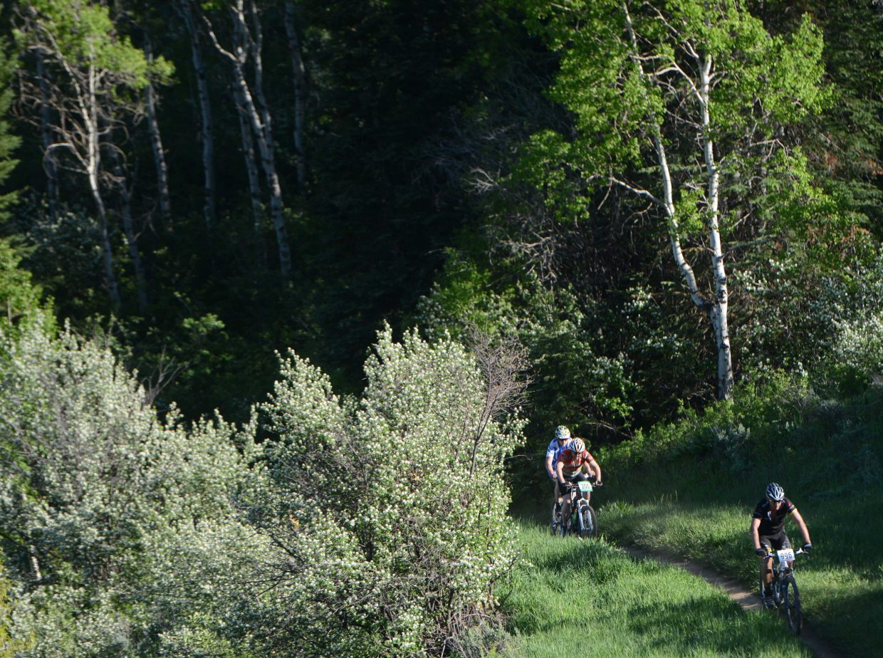 Riders head up the course Wednesday in the Town Challenge race at Emerald Mountain.