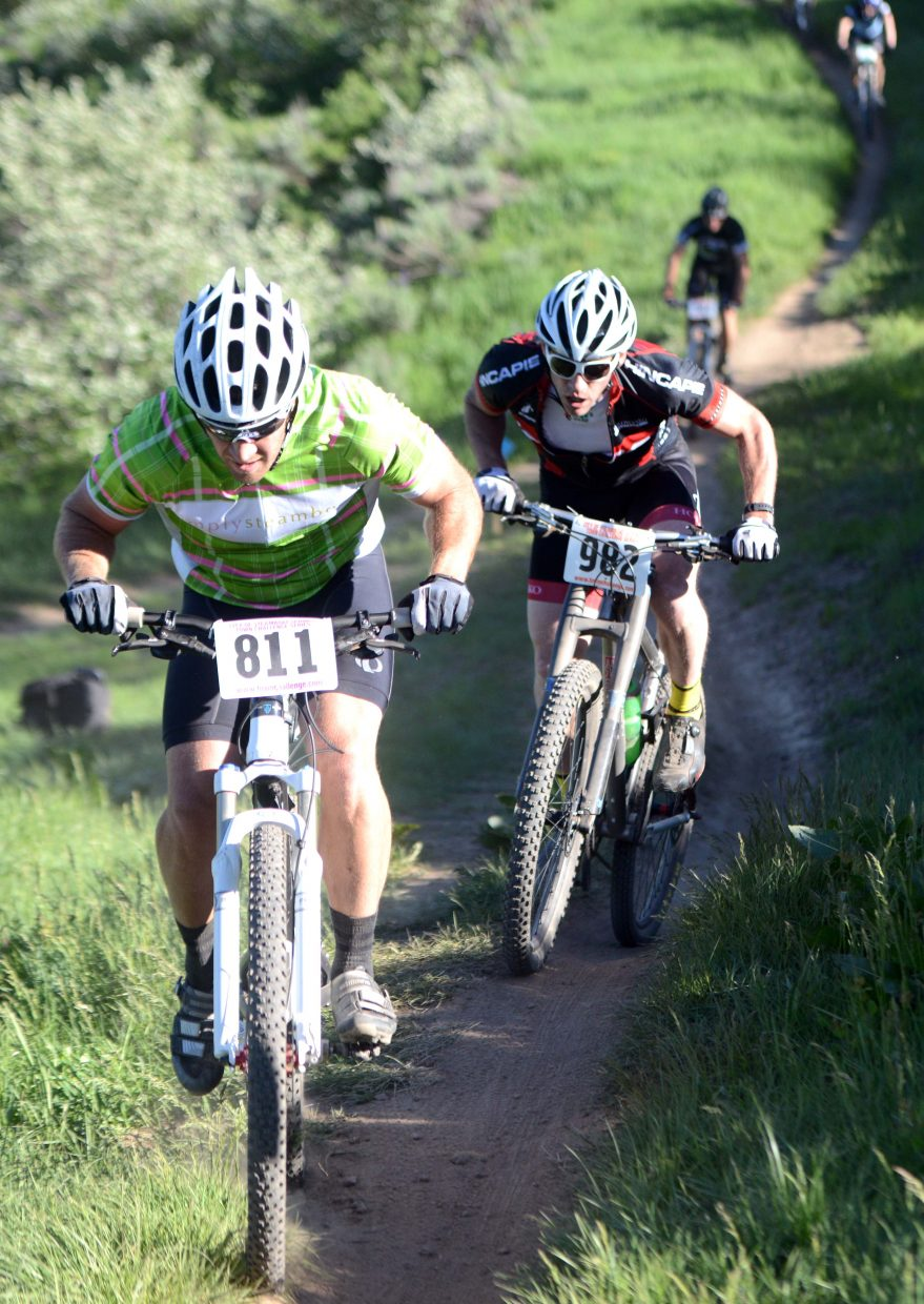 Jeff Snook, 811, and Jon Freckleton ride Wednesday in the Town Challenge race at Emerald Mountain.