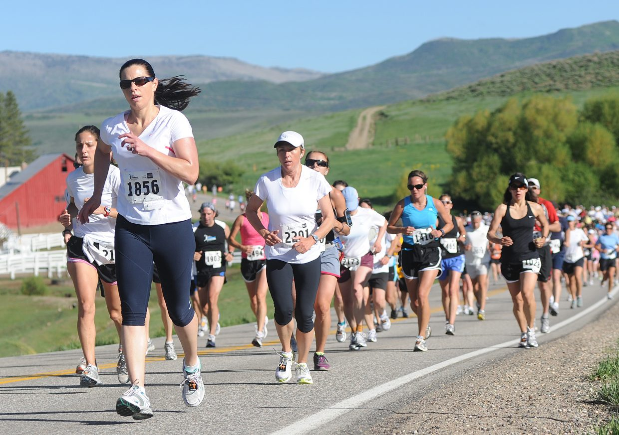 Kristina Stefka leads a massive pack of runners in the half marathon Sunday during the 29th annual Steamboat Marathon. More than 2,000 competitors showed up for the day's events.