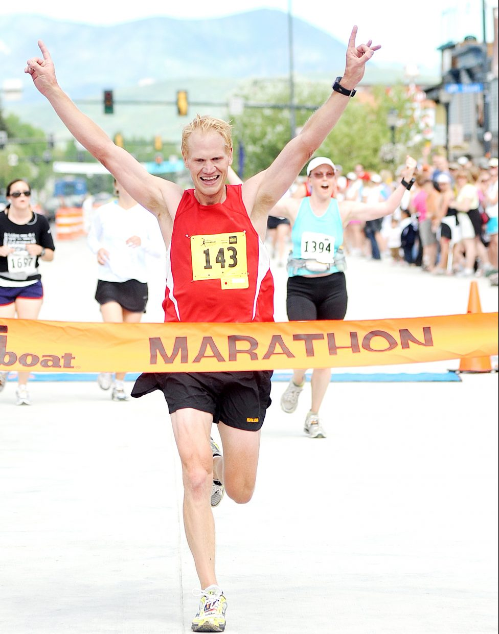 Dan Edstrom, of Denver, throws his arms up as he crosses the finish line to win the 2010 Steamboat Marathon. He finished the 26.2 mile race in 2 hours, 47 minutes and 37 seconds.