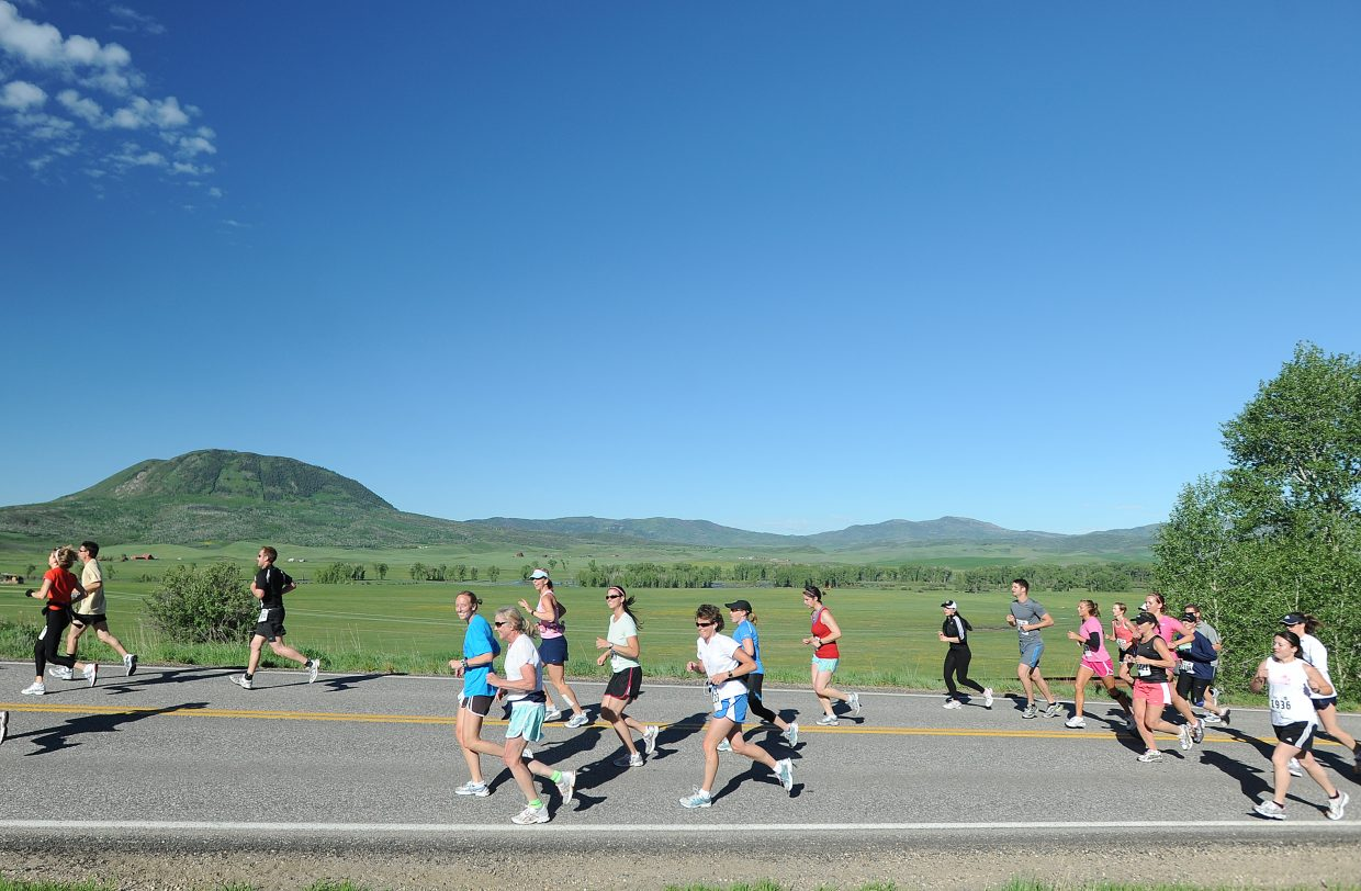 Runners head toward Steamboat Springs on Sunday during the 29th annual Steamboat Marathon.
