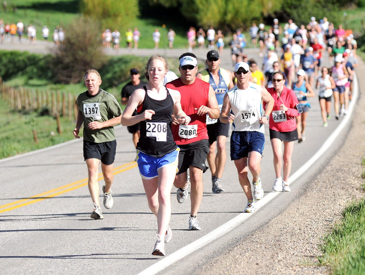 Half-marathon runners make their way down Elk River Road toward Steamboat Springs during the 29th annual Steamboat Marathon, half marathon and 10K.
