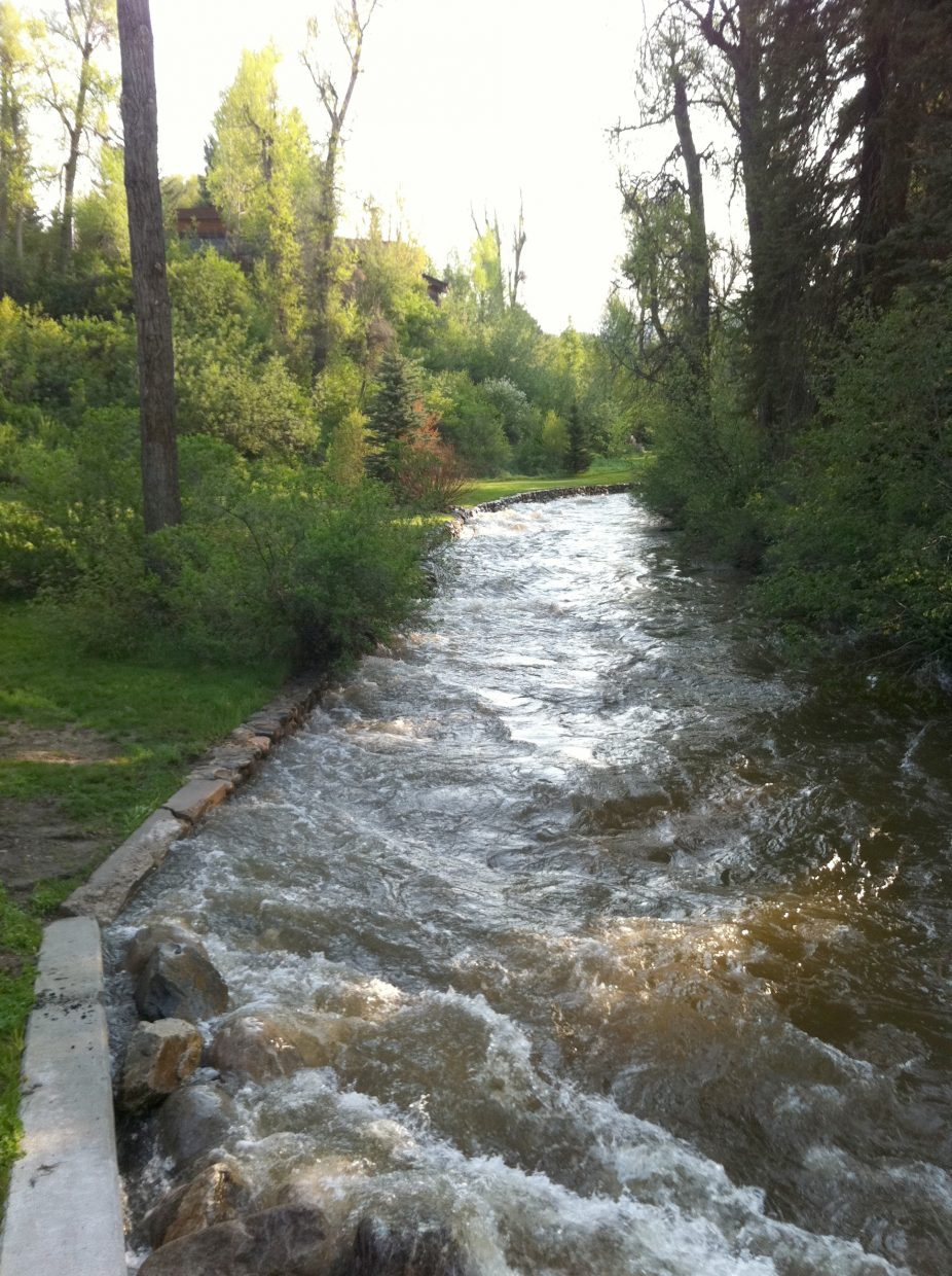 Soda Creek surges through Old Town Steamboat early Monday morning.
