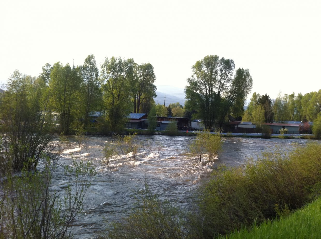 The Yampa River flows past the Fish Creek Mobile Home Park on Monday.