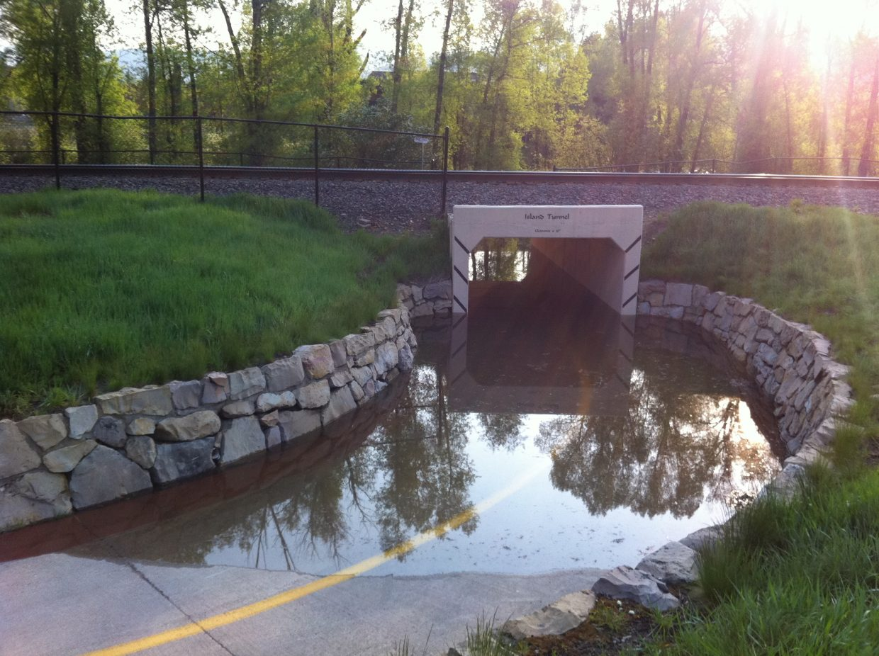 The Island Tunnel on the Yampa River Core Trail was under several feet of water Monday morning.