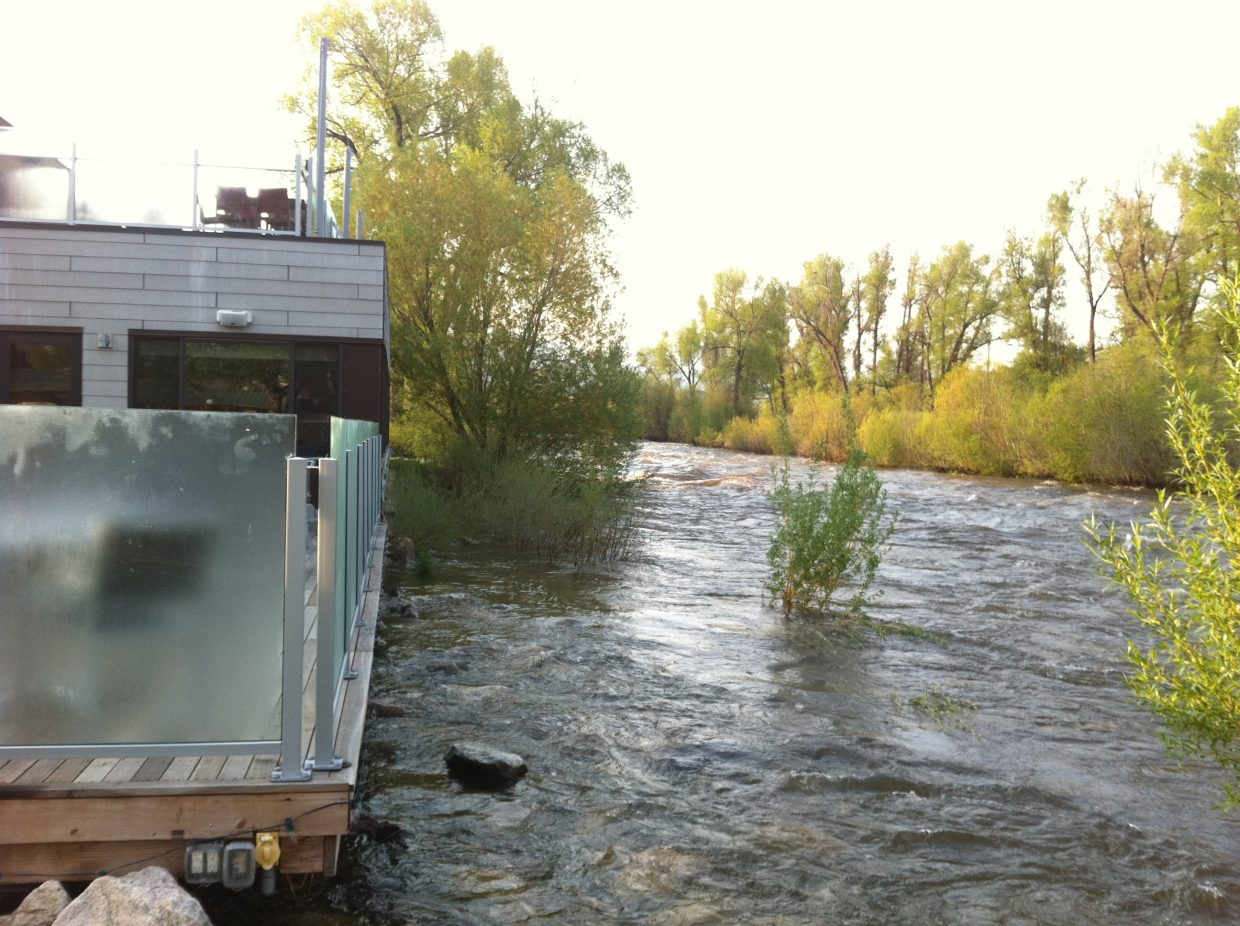 The Yampa River creeps up to the outdoor seating area at Sweetwater Grill in downtown Steamboat on Monday.