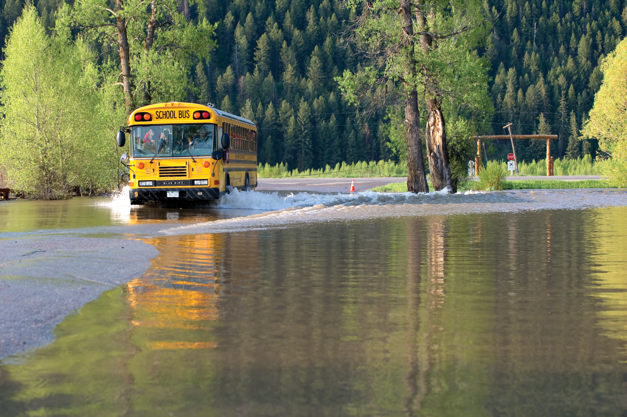 A school bus drives through about 6 inches of water on Routt County Road 44 on Monday morning just west of Steamboat Springs.