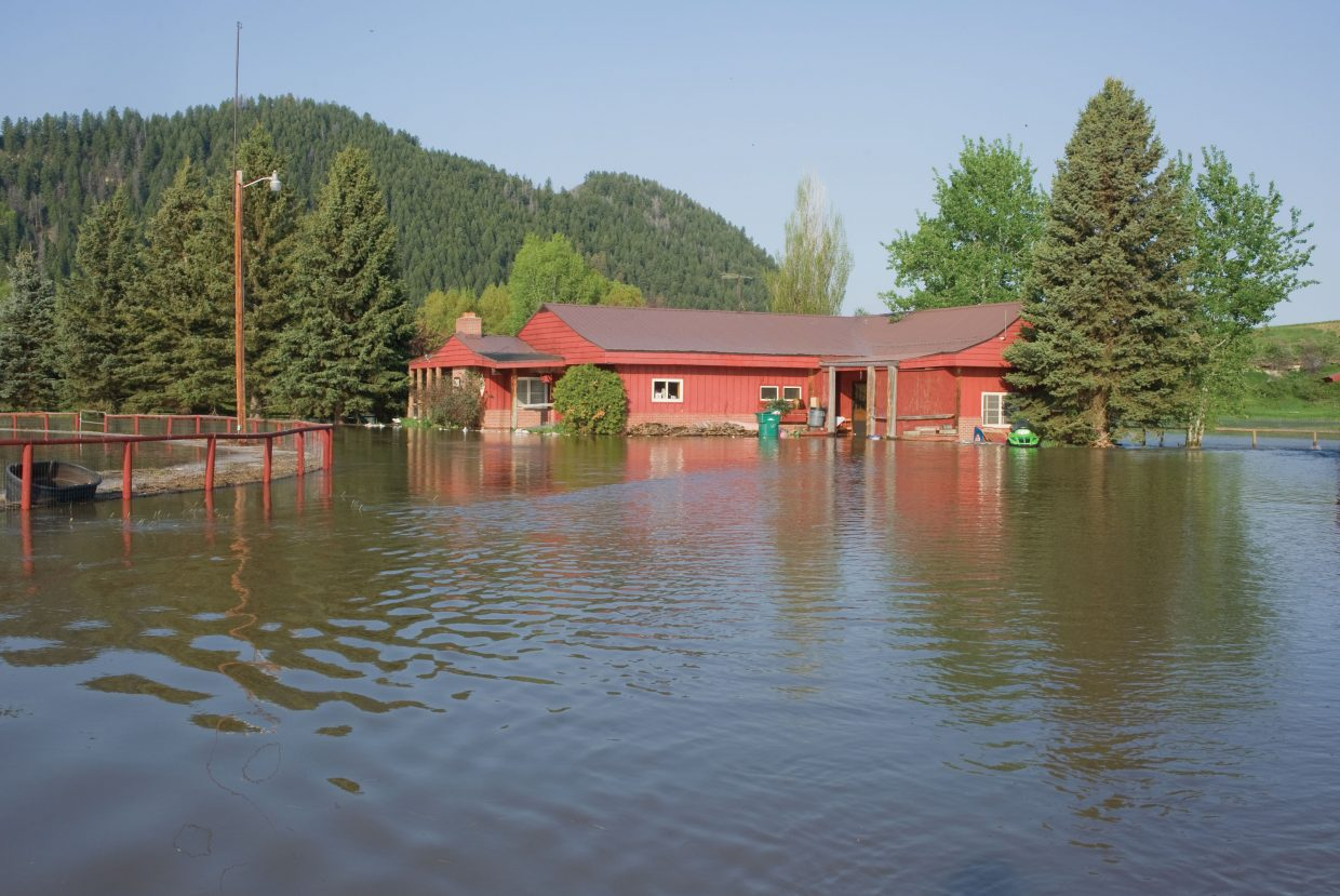 Water from the Elk River has overtaken several buildings at Saddle Mountain Ranch just west of Steamboat Springs. The residents of the home voluntarily evacuated the property Friday as the water from the Elk and Yampa rivers were forecast to rise.