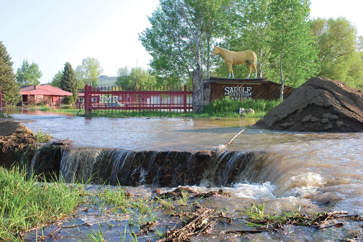 Water from the Elk River has washed out part of the driveway at Saddle Mountain Ranch just west of Steamboat Springs.