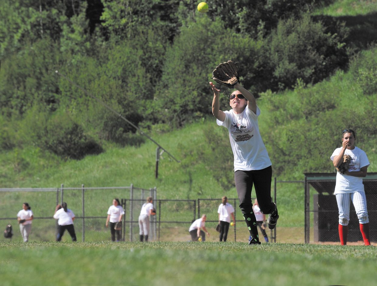 Paige Pelton snags a fly ball Wednesday during a girls softball camp hosted by Triple Crown.