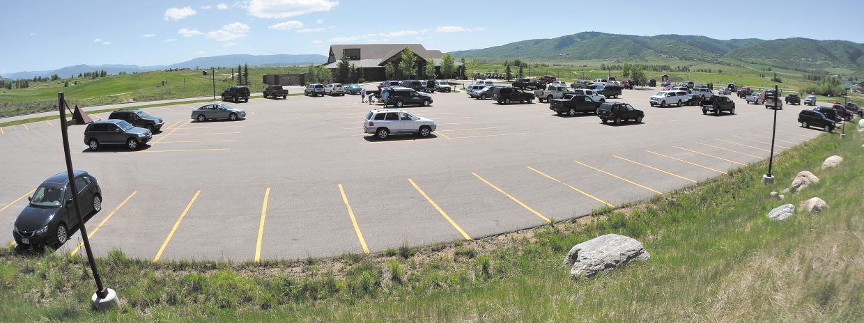 Cars fill the parking lot at the Haymaker Golf Course on Wednesday afternoon.