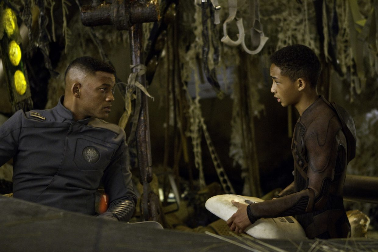 """Cypher and Kitai (Will and Jaden Smith) assess their situation in """"After Earth."""" The movie is about a father and son in the distant future who crash land on a drastically different planet Earth, with the son responsible for saving his ailing father."""