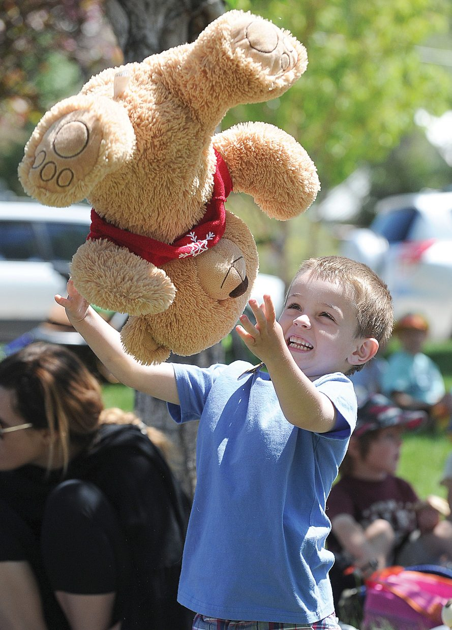 Four-year-old Charlie Gunn plays at the Teddy Bear Picnic at Bud Werner Memorial Library on Thursday afternoon. Children were invited to enjoy lunch with their favorite stuffed friend. The event featured music by the Yampa Valley Boys and crafts.