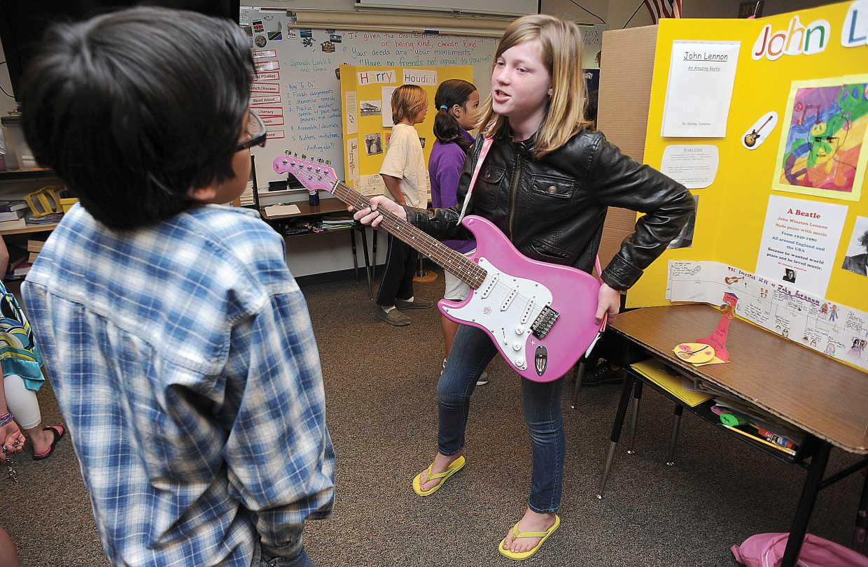 Strawberry Park Elementary School fifth-grader Delaney Johnston plays the role of John Lennon on Thursday during a run-through for a living wax museum. The students will perform from 9:30 a.m. to 11 a.m. Friday at the school.