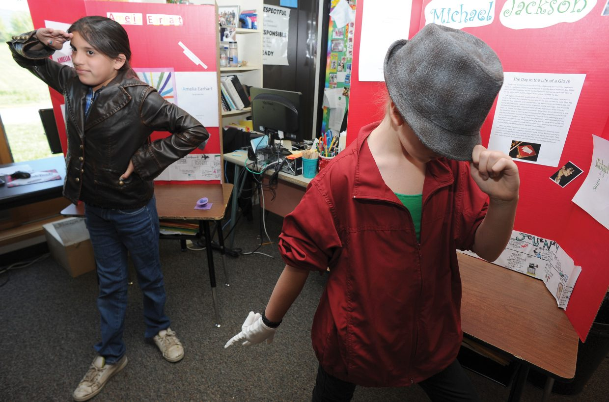Stawberry Park Elementary School fifth-graders Tasi Harrington, front, and Abigail Clark play their roles as Michael Jackson and Amelia Earhart, respectively, during a run-through for a living wax museum. The students will perform from 9:30 a.m. to 11 a.m. Friday at the school.