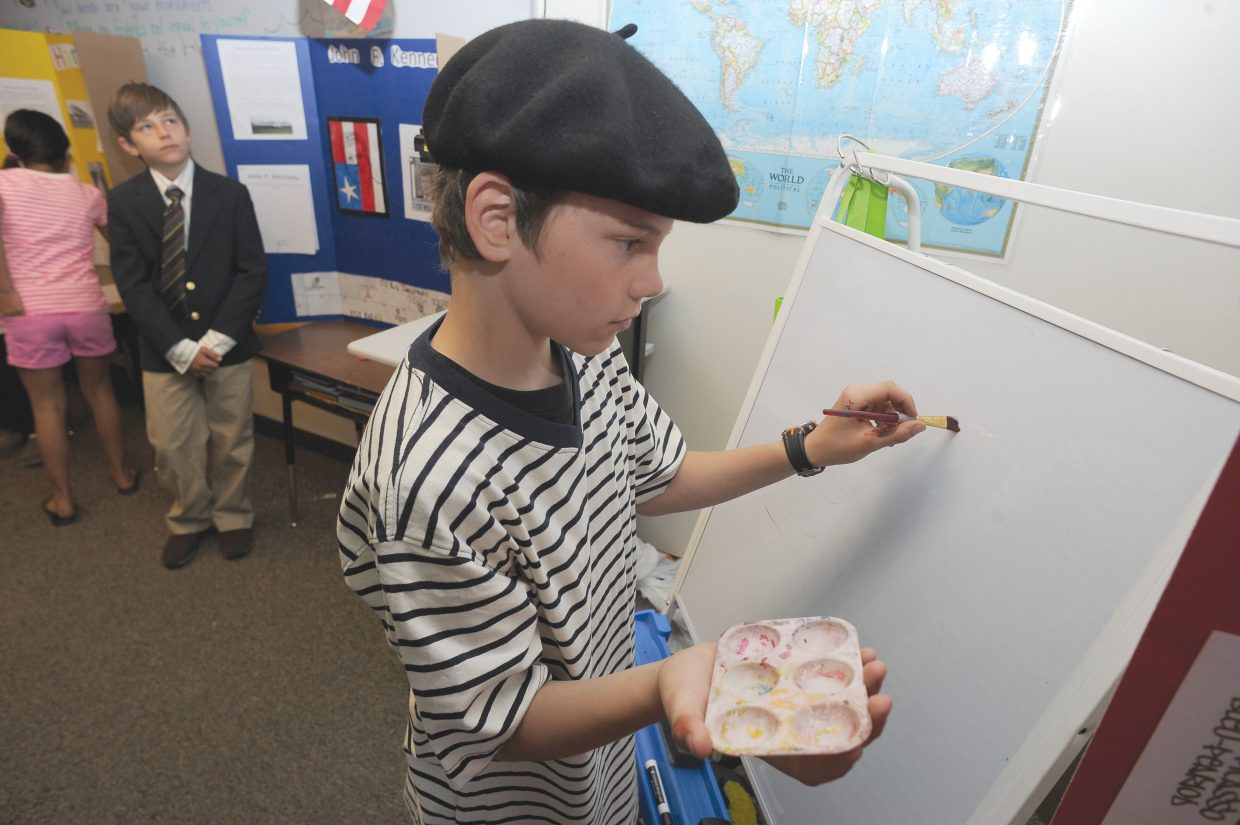 Strawberry Park Elementary School fifth-grader Monroe Parks plays the role of Pablo Picasso during a run-through for a living wax museum. The students will perform from 9:30 a.m. to 11 a.m. Friday at the school.