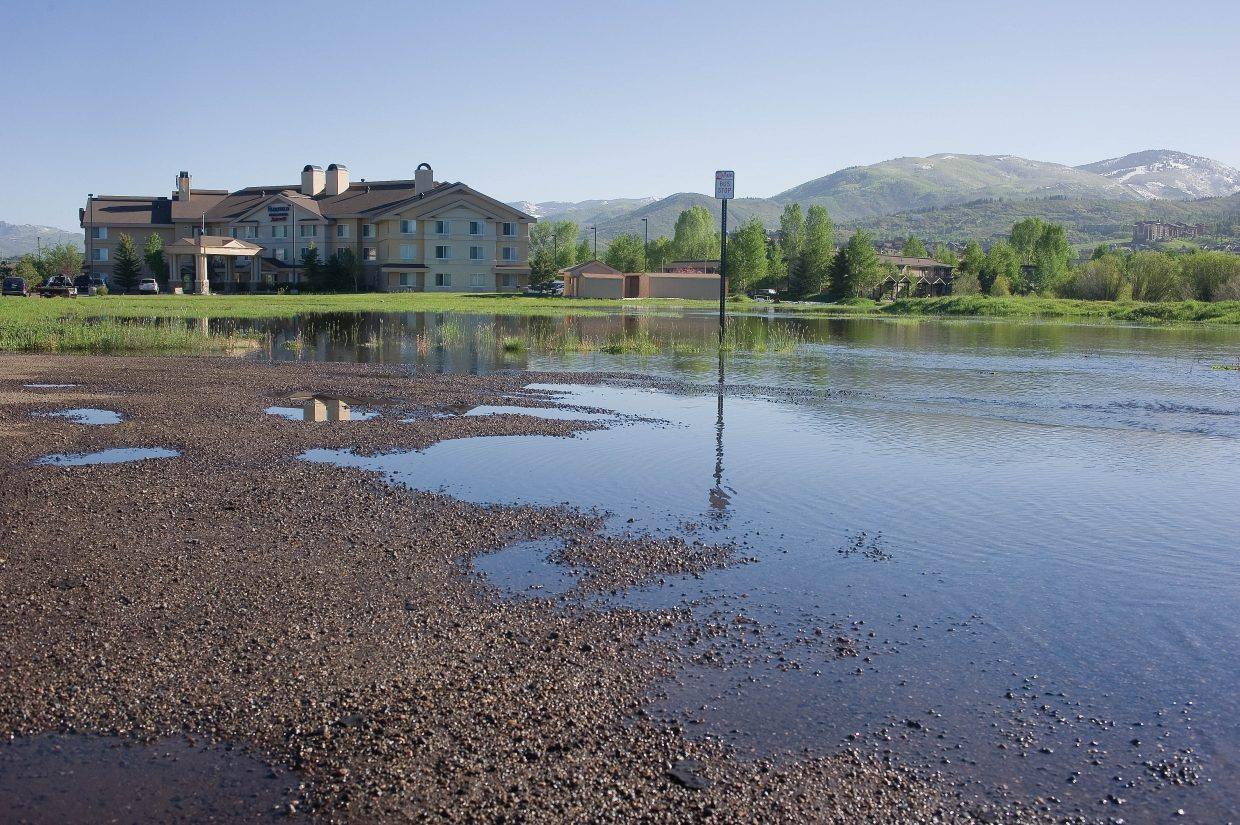 Water from Walton Creek had flooded a small field near the Fairfield Inn & Suites near just off of U.S. Highway 40 in Steamboat Springs on Tuesday.