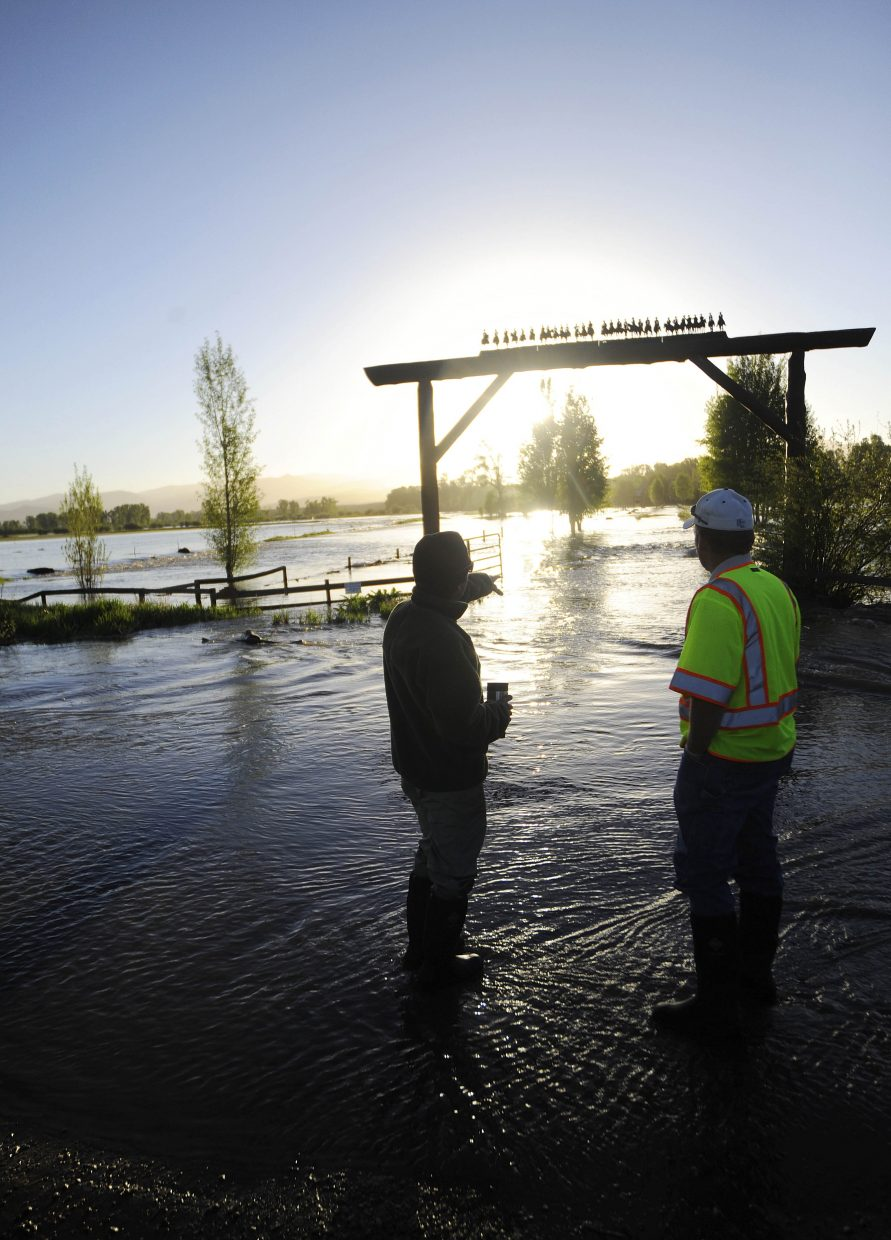 Routt County Office of Emergency Management Director Bob Struble, right, talks with Davis Krouse Ranch caretaker Yuri Goldstein on Tuesday morning at the entrance to the ranch near U.S. Highway 40 and Routt County Road 44.