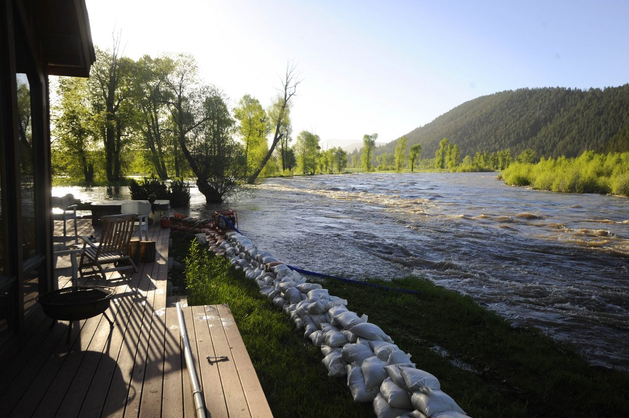 The Yampa River flows alongside Kent Osteen's home Tuesday morning.