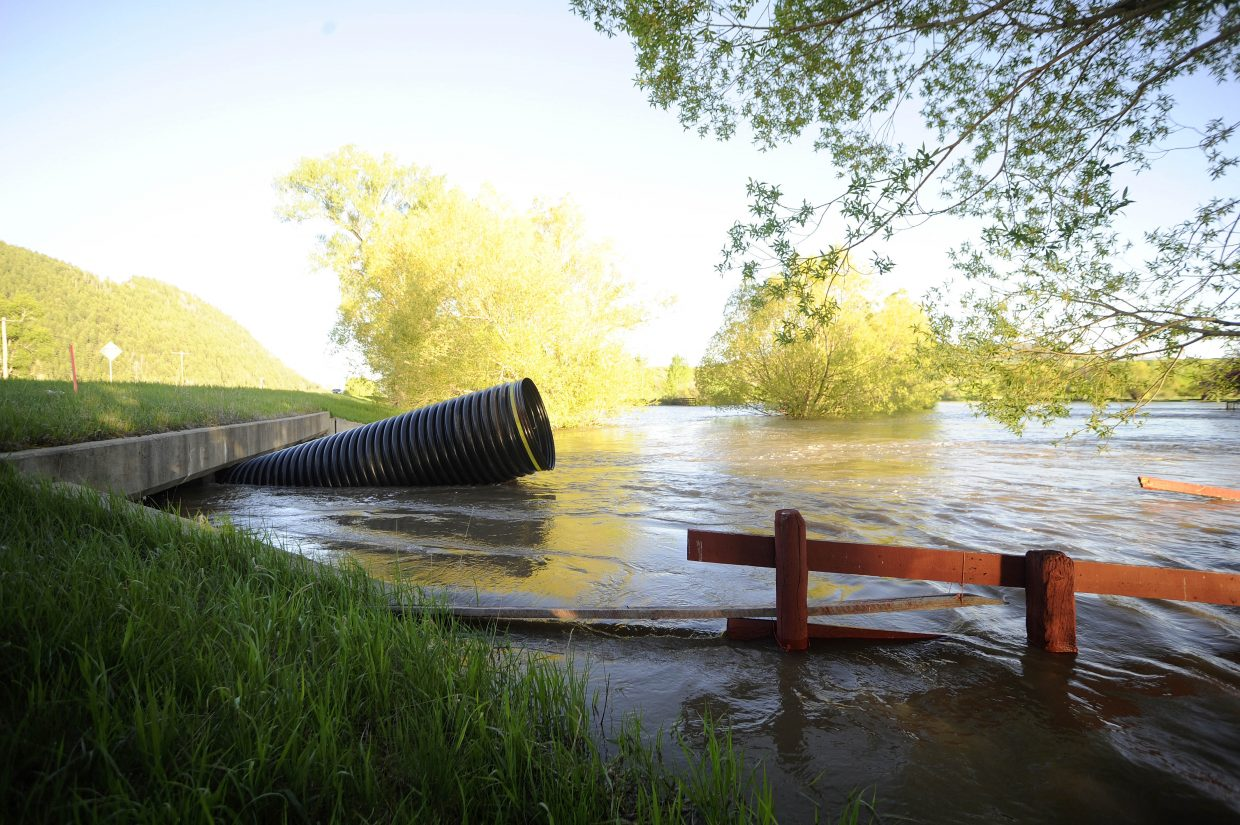 A large piece of culvert washed away from the driveway at Saddle Mountain Ranch and was stuck in a culvert going under U.S. Highway 40 on Tuesday.