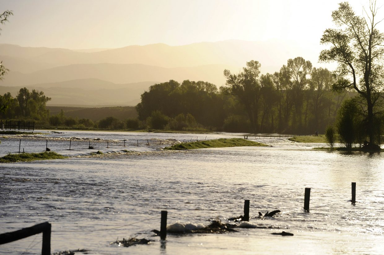 Water flows over the fields at the Davis Krouse Ranch on Tuesday morning near U.S. Highway 40 and Routt County Road 44.