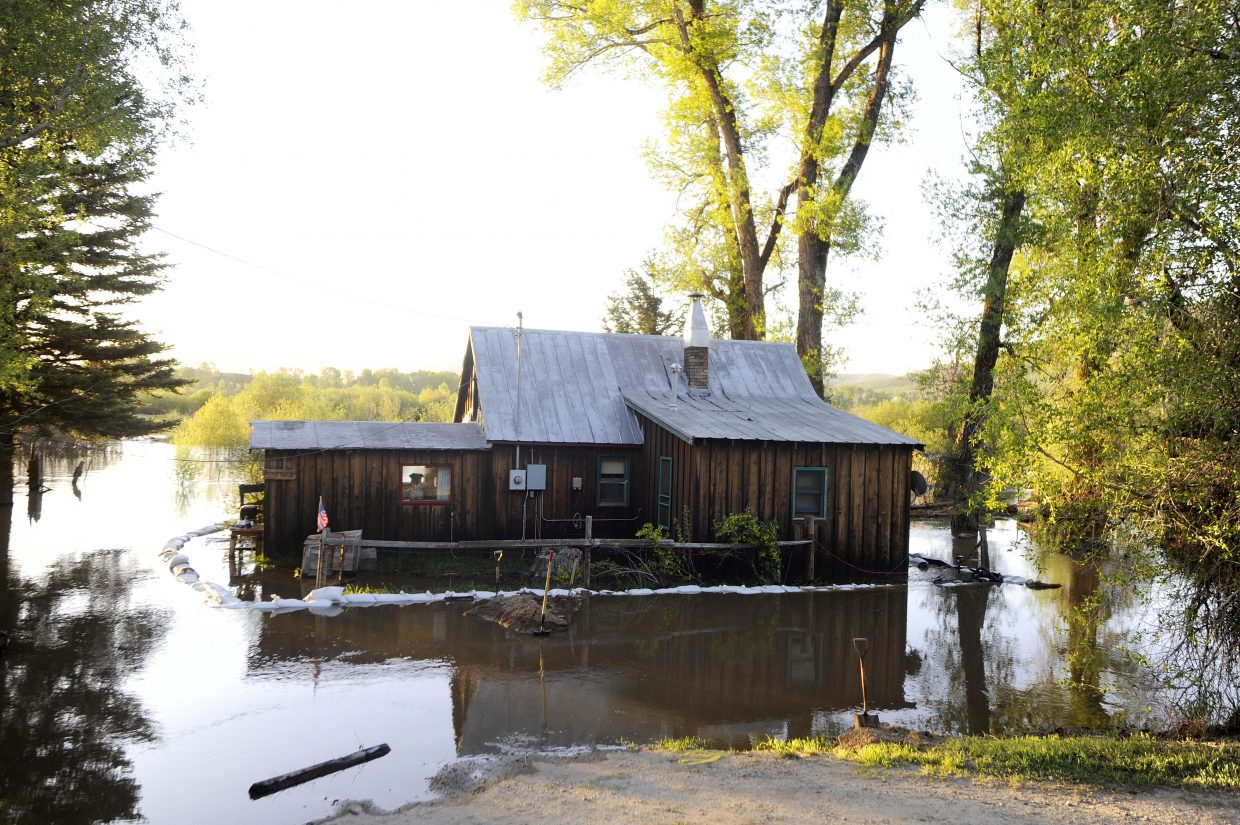 A home that Tom and Linda Peretic rent along Routt County Road 44 was surrounded by water Tuesday morning, but they say it did not enter the home.