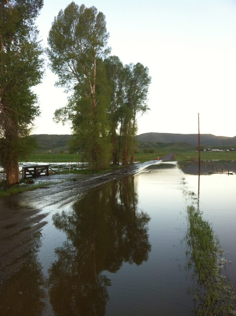 Floodwaters from the Elk River run across Routt County Road 42 early Tuesday morning west of Steamboat Springs.
