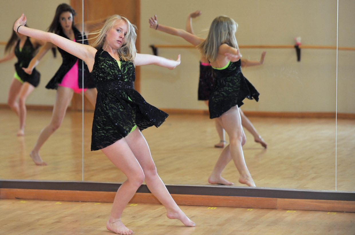 """Dancer Caroline Wilson rehearses a contemporary piece last week at Elevation Dance Studio while preparing for Saturday's """"School of Rock"""" recital, which will take place at 11 a.m. and 5 p.m."""