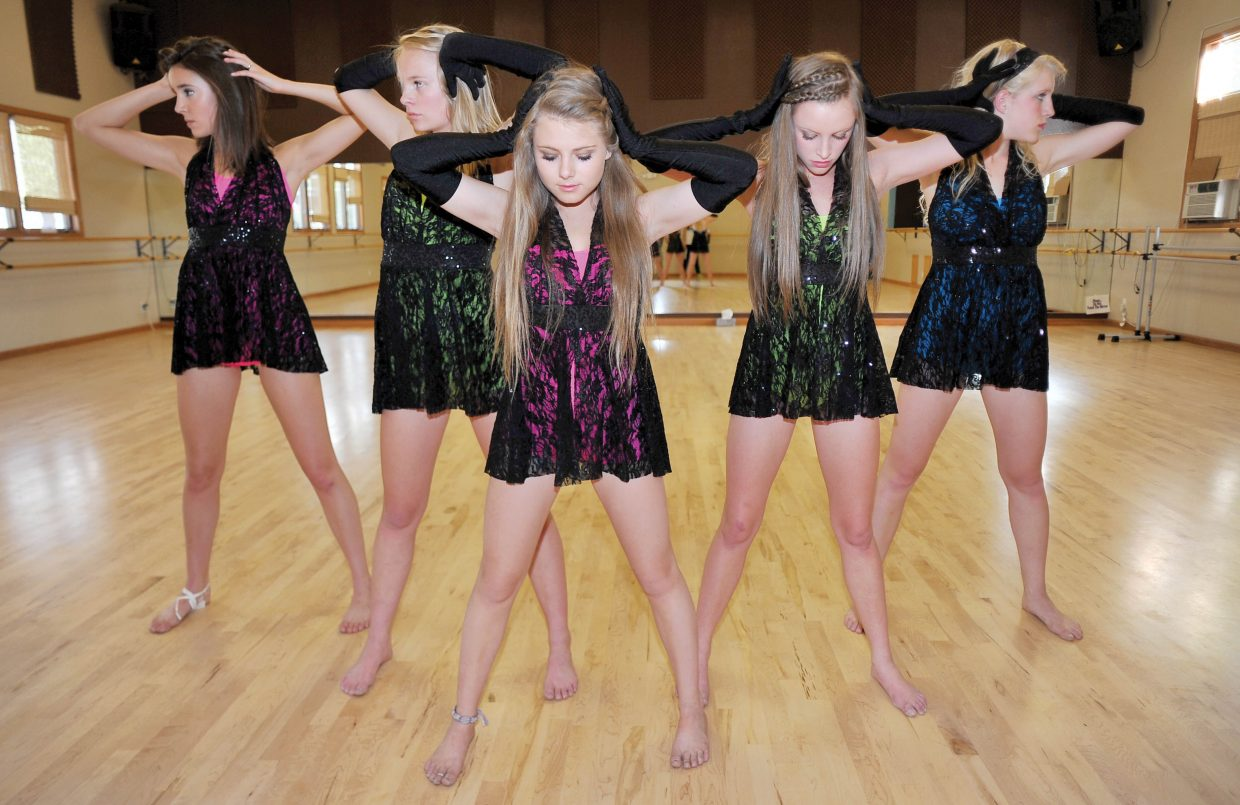 """Dancers rehearse a contemporary piece last week at Elevation Dance Studio while preparing for Saturday's """"School of Rock"""" recital, which will take place at 11 a.m. and 5 p.m. Dancers include, from left, Jane Robey, Caroline Wilson, Anna Henderson, Maggie McElhiney and Malia Fraioli."""
