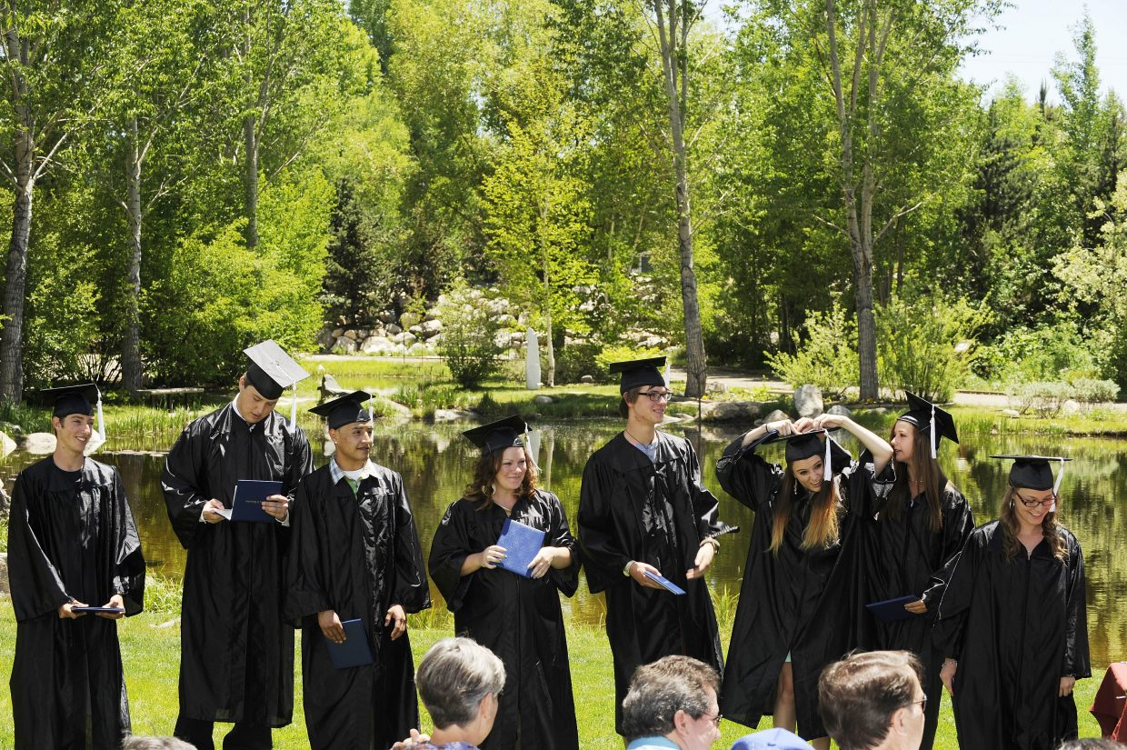 Eight graduates are recognized during the Yampa Valley High School graduation ceremony Friday at Yampa River Botanic Park.