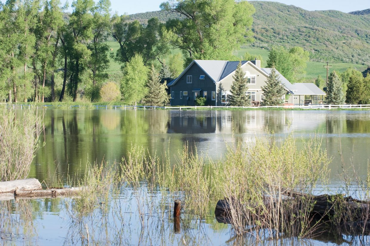 Not even high dirt berms could protect this home on Routt County Road 44 just west of Steamboat Springs from the rising waters of the Elk River. The home, which is now surrounded up to the foundation in water, is normally located in the middle of farmland and open fields.