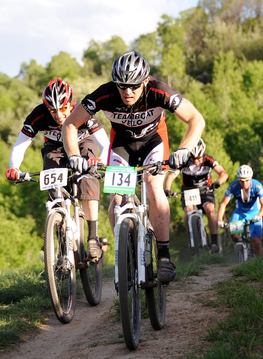 Pat West leads a pack of riders on Wednesday during the season's first Town Challenge Mountain Bike Race in Steamboat Springs. The race, which took place on Emerald Mountain, drew more than 180 racers.