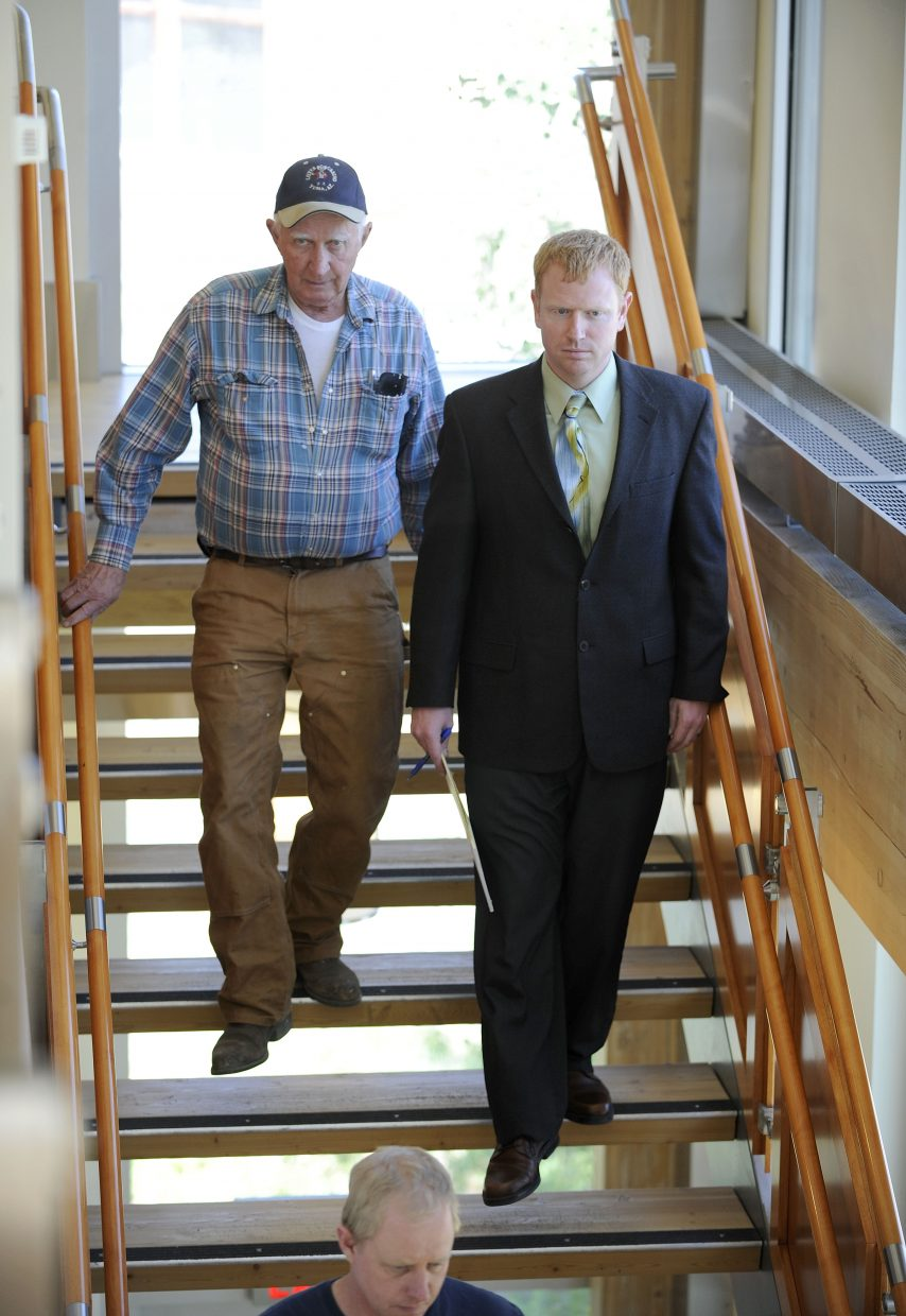 Del Herman, left, walks with his attorney Reed Morris after the jury read its verdict Friday at the Routt County Justice Center.