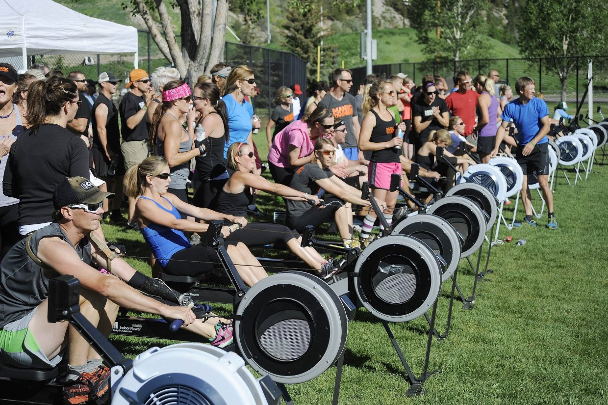 Local athletes pull on rowing machines Saturday morning at Howelsen Hill during a benefit for Steamboat Springs physical therapist Scott Blair, who was diagnosed with a brain tumor in May. There were 20 teams, each with a rower who was trying to row the most meters in an hour. The rowing competition organized by Manic Training raised more than $12,000 and was one of several Sweat for Scott benefits held this weekend for Blair.