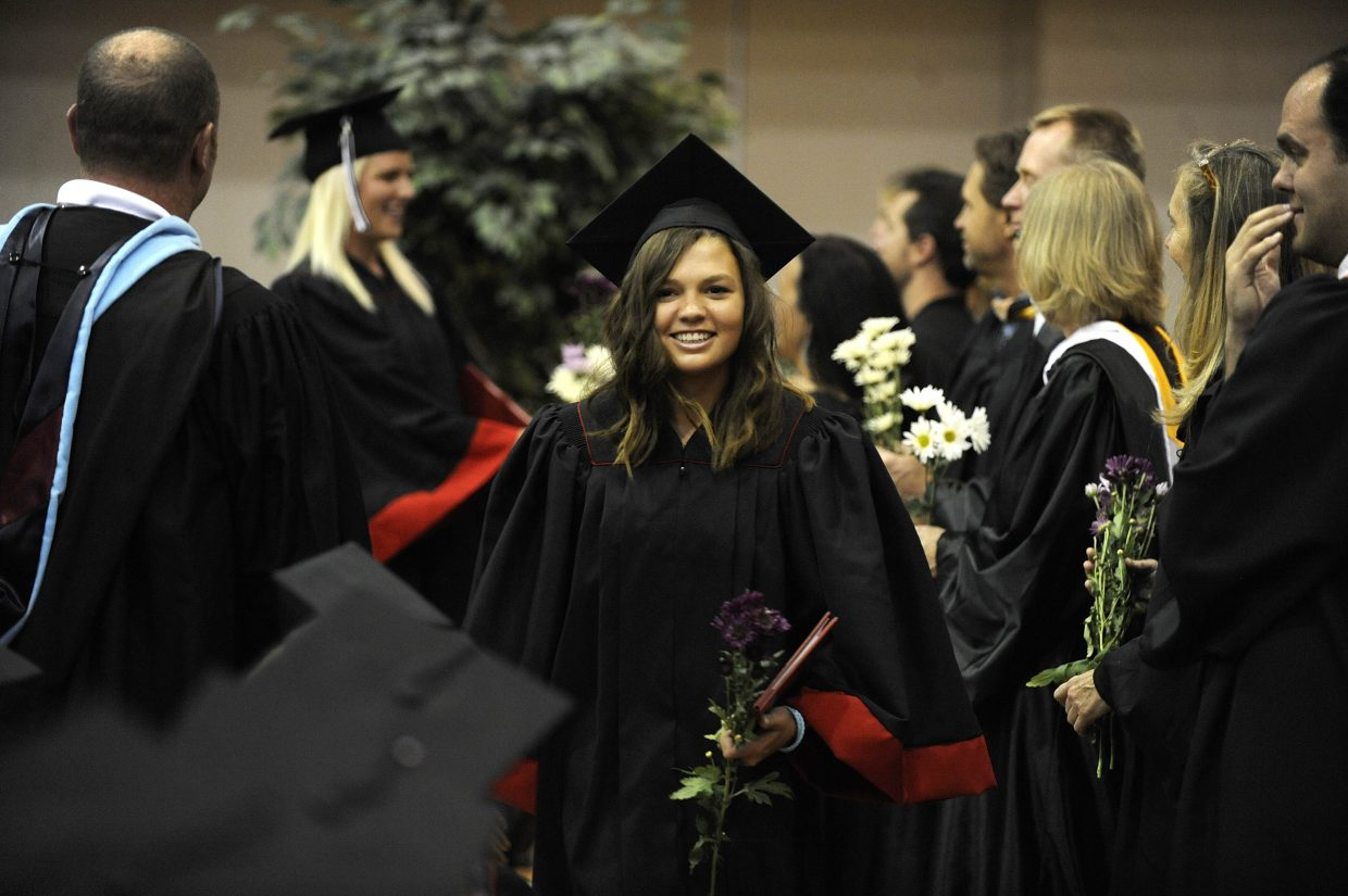 Megan Stabile receives her diploma Saturday at Steamboat Springs High School.