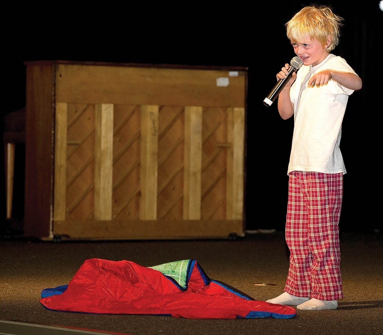 """Soda Creek Elementary School third-grader Liam Baxter performs an act based on the song """"Fireflies"""" on the final day of school Thursday during the End of the Year Talent Show."""