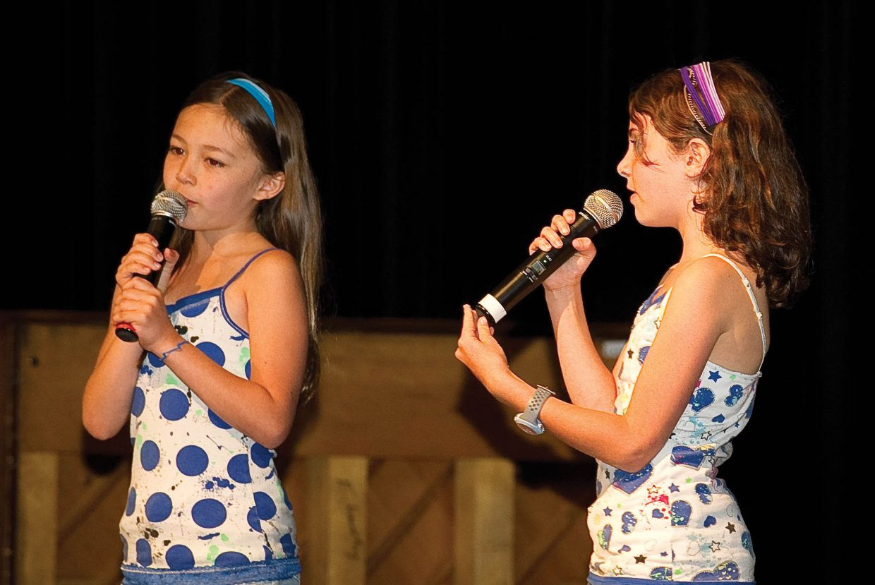 """Soda Creek Elementary School third-graders Madison Truong, left, and Elise Barbier perform """"Who Says"""" on the final day of school Thursday during the End of the Year Talent Show."""