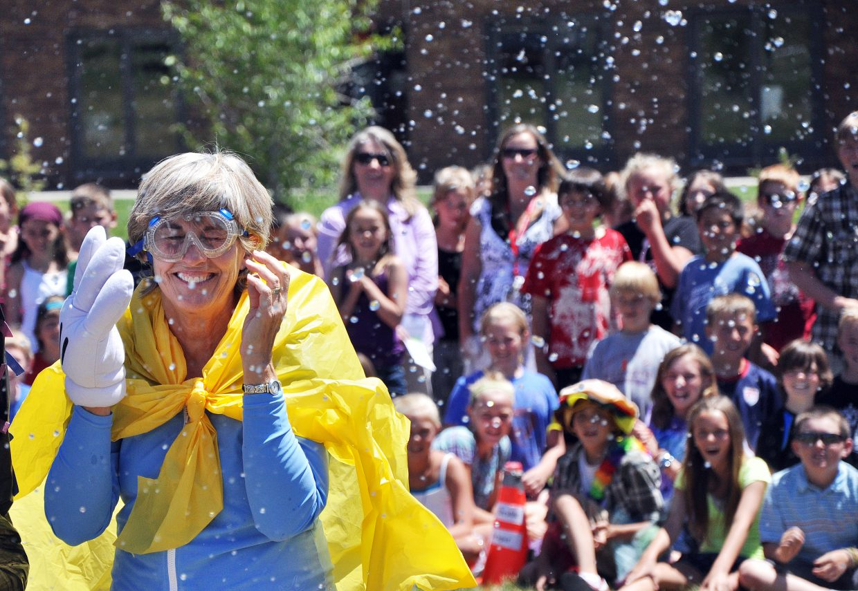 Strawberry Park Elementary School students and teachers watch Principal Celia Dunham attempt to avoid an onslaught of water balloons Thursday on the last day of school. Dunham, who has served the Steamboat Springs School District for 34 years, will start her retirement next month.
