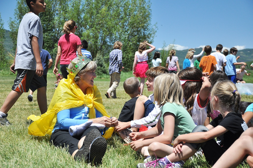 Strawberry Park Elementary School Principal Dunham sits with students Thursday on the last day of school.